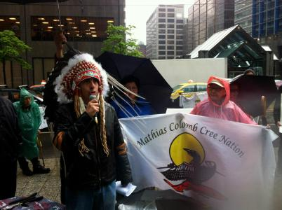 Chief Arlen Dumas of the Mathias Colomb Cree Nation spoke to the crowd gathered to confront Hudbay over its illegal operations on their territory and across Turtle Island. Photo by Clayton Thomas-Muller.