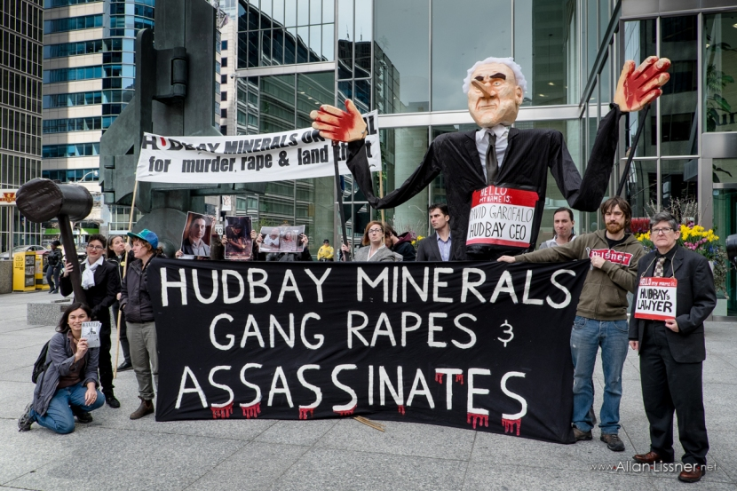Members and supporters of the Mining Injustice Solidarity Network gather after the guilty verdict was declared in the Peoples Trial held outside Hudbay's AGM.