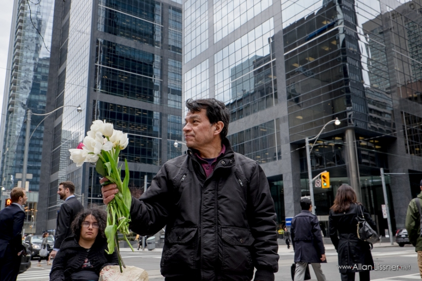 Marco Castillo led the memorial in front of the 130 Adelaide W. tower, where Goldcorp's Toronto office is. Photo by Allan Lissner.